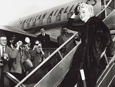 Marilyn Monroe Boards Airplane, New York, c.1956--Art Print