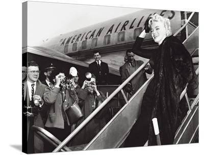 Marilyn Monroe Boards Airplane, New York, c.1956--Stretched Canvas Print