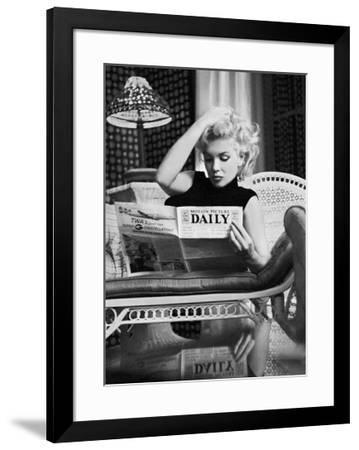Marilyn Monroe Reading Motion Picture Daily, New York, c.1955-Ed Feingersh-Framed Art Print