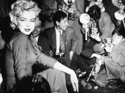 Marilyn Monroe Surronded by Photographers C. 1955