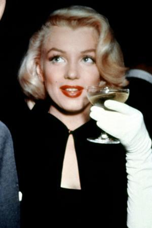Marilyn Monroe with a Glass of Champagne, 1955