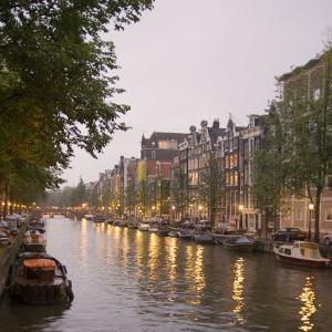 Boat Lined Canal at Dusk, Amsterdam, Netherlands by Marilyn Parver