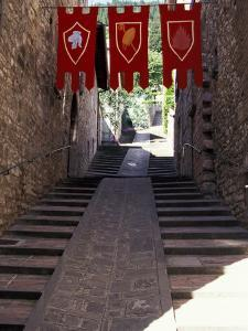 Medieval Flags Above Stone Walkway, Assisi, Umbria, Italy by Marilyn Parver