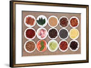 Large Spice, Herb And Food Ingredient Selection In White Porcelain Bowls Over Hessian Background by marilyna