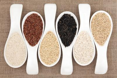 Rice Grain Selection In White Porcelain Scoops Over Hessian Background