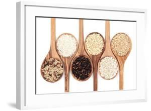 Rice Varieties In Olive Wood Spoons Over White Background by marilyna