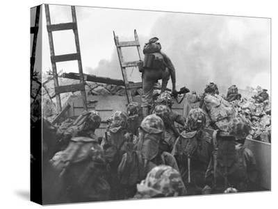 Marine Lt. Baldomero Lopez Scaling a Seawall after Landing on Red Beach in the Invasion of Inchon