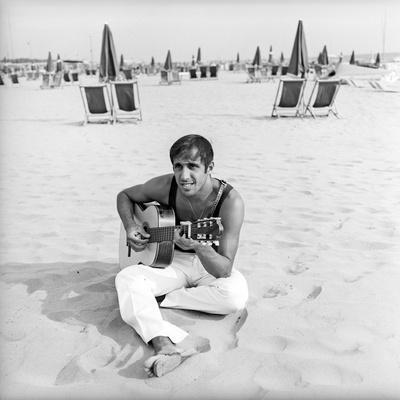 Adriano Celentano with the Guitar at the Beach