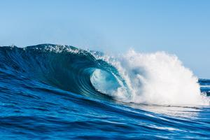 Blue Barrel-Powerful wave breaking off a beach, Hawaii by Mark A Johnson