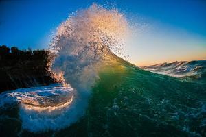 Sunset Spray-Wave breaking off N. Stradbroke Island, Queensland, Australia by Mark A Johnson