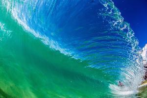 Water shot of a tubing wave off a Hawaiian beach by Mark A Johnson