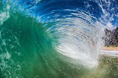 Water shot of a tubing wave off a Hawaiian beach