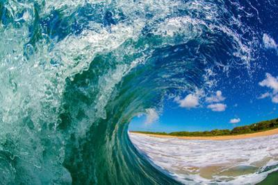 Water shot of a tubing wave off a Hawaiian beach