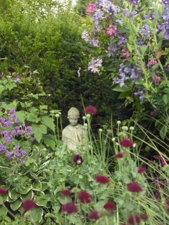 Small Statue in a Back Garden