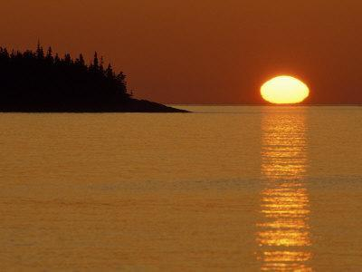 Spring Sunrise Silhouettes Edwards Island and Reflects Light on Lake Superior