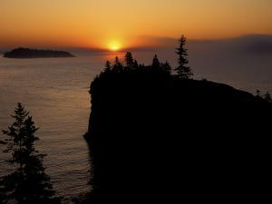 Spring Sunrise Silhouettes Edwards Island and Scoville Point on Lake Superior by Mark Carlson