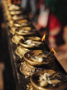 Butter Lamps, Kathmandu, Nepal, Asia by Mark Chivers