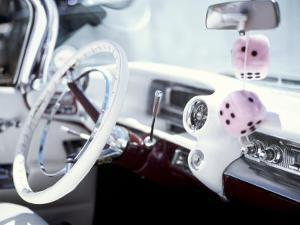 Close-Up of Steering Wheel and Interior of a Pink Cadillac Car by Mark Chivers