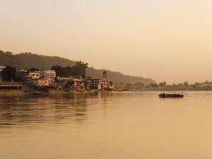 Ferry Crosssing the River Ganges at Sunset, Haridwar, Uttaranchal, India, Asia by Mark Chivers