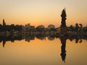 Statue of Shiva Rising Out of a Lake Sur Sagar in the Centre of Vadodara, Gujarat, India, Asia by Mark Chivers
