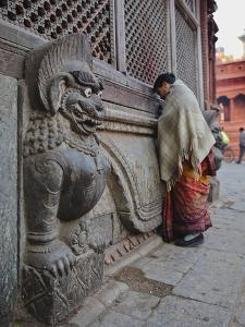 Stone Lions Guard a Prayer Wall in Durbar Square, Kathmandu, Nepal, Asia by Mark Chivers