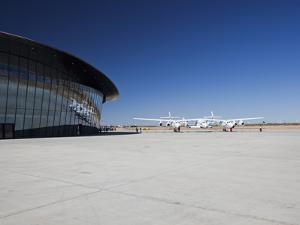 Virgin Galactic's White Knight 2 with Spaceship 2 on the Runway at the Virgin Galactic Gateway Spac by Mark Chivers