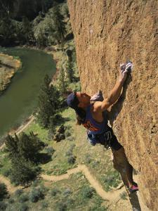 Climber on Smith Rock Above the Crooked River by Mark Cosslett