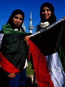 Girls with Kuwaiti Flags to Greet Amir of Kuwait, Kuwait by Mark Daffey