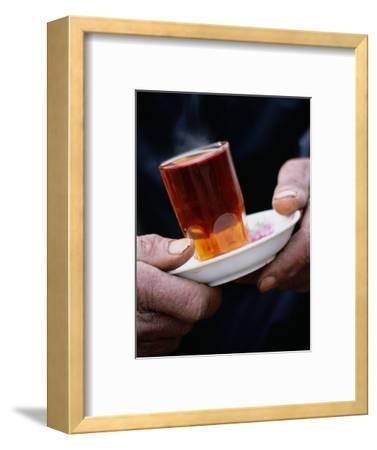 Man Holding a Glass of Tea, Esfahan, Iran