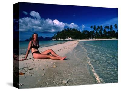 Woman Sunbathing on Sand Spit of Snick Island, El Nido, Philippines