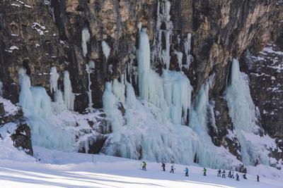 Skiers Underneath the Frozen Waterfall, Ski Piste by Mark Doherty