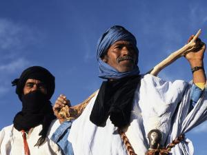 Berber Tribesmen in the Sand Dunes of the Erg Chegaga, in the Sahara Region of Morocco by Mark Hannaford