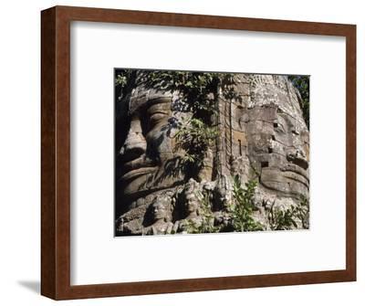 Detail of Carved Faces at Baray Temple, Angkor Wat, Cambodia