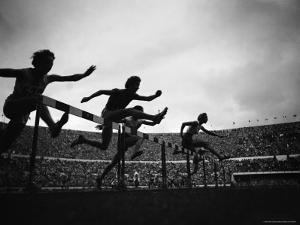 Action During the Women's 100m Hurdles at the 1952 Olympic Games in Helsinki by Mark Kauffman