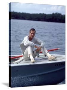 Actor Paul Newman Enjoying a Heineken Beer on the Prow of a Boat by Mark Kauffman