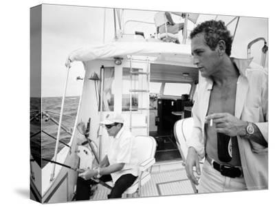 Actor Paul Newman Fishing with a Friend