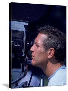 Actor Paul Newman Looking Through a Camera by Mark Kauffman