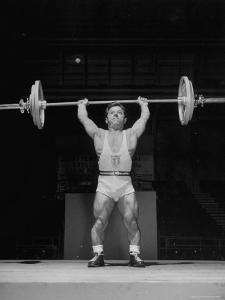 American Bantamweight Joseph Depietro Competing in Weightlifting Event at Summer Olympics by Mark Kauffman