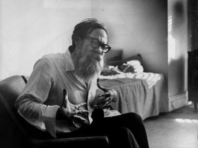 American Poet John Berryman Expressing Himself While Sitting in His Semi Empty Apartment