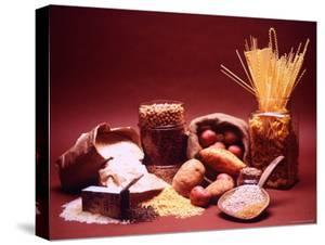 Arrangement of Earthy Foods Including Uncooked Barley, Cracked Oats, Wild Rice, and Various Pasta by Mark Kauffman
