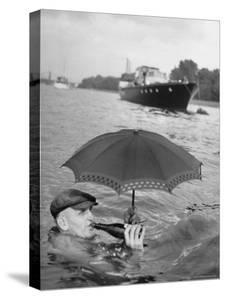 British Water Treader Joseph G. Simms in the Middle of the Thames River by Mark Kauffman