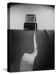 Cash Register, Type Used in Supermarkets, with Purchase Receipt Being Ejected in Foreground by Mark Kauffman