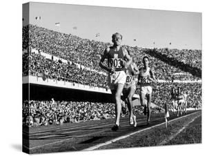 Czech Track and Field Gold Medalist Emil Zatopek, Leading Pack, Competing in 1952 Olympic Games by Mark Kauffman