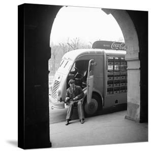 Delivery Truck Driver Sits with His Coca Cola Truck During His Route, France, 1950 by Mark Kauffman