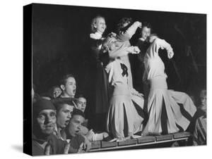 Duke Cheerleaders Cheering Amound the Fans in the Bleachers by Mark Kauffman