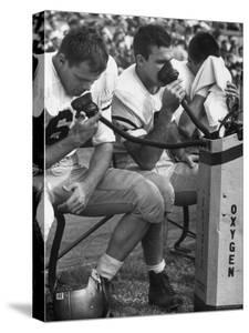 Duke Football Players Breathing Oxygen from a Bottle During the Game by Mark Kauffman
