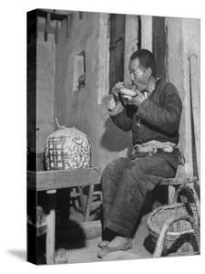 Farmer Eating Noodles at Tea Shop by Mark Kauffman