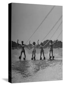Four People Competing in the National Water Skiing Championship Tournament by Mark Kauffman