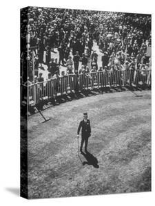 Man Standing in the Center of the Royal Enclosure at Ascot Race Track by Mark Kauffman