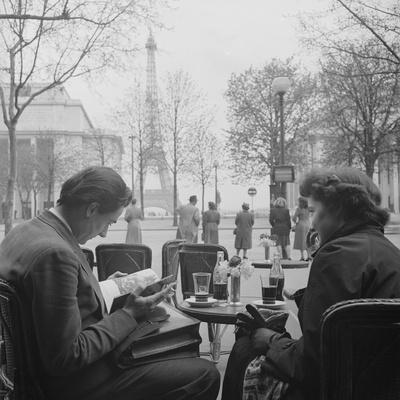 Parisian Couple Drinking Coca Cola at a Sidewalk Cafe While Reading, Paris, France, 1950
